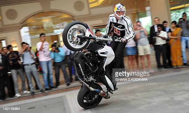 World stunt-riding champion Chris Pfeiffer performs outside hotel in Colombo on February 28, 2012. The German rider is in Sri Lanka for a series of...