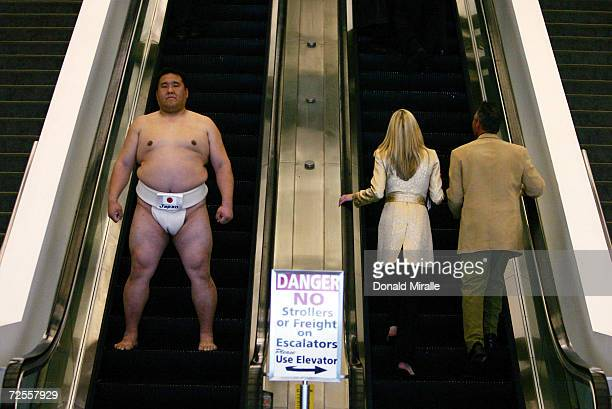 World Sumo Champion and Japanese National Champion Koichi Kato takes an escalator during the US Sumo Open at the Los Angeles Convention Center on...