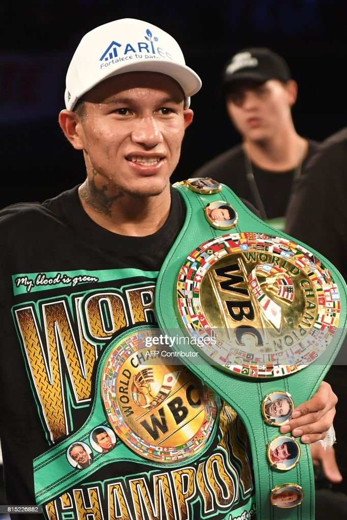 WBC World Super Featherweight champion Miguel Berchelt smiles after defeating Japan's Takashi Miura by unanimous decision to retrain his title, July 15, 2017 at The Forum in Inglewood, California. / AFP PHOTO / Robyn Beck