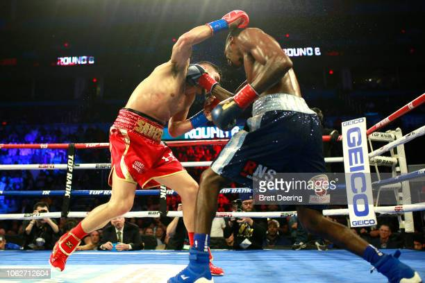World super lightweight champion Maurice Hooker, right, and challenger Alex Saucedo fight for the title at Chesapeake Energy Arena on November 16,...