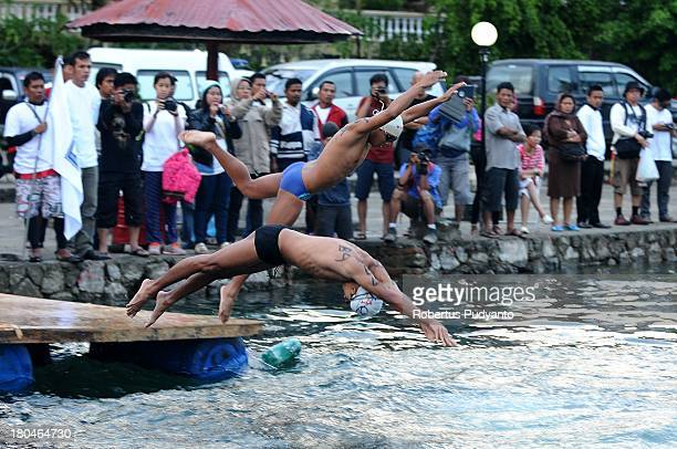 World Super Swim athletes swimming around Samosir Island in total distance 117 km as part of Lake Toba Festival 2013 on September 13 2013 in Medan...