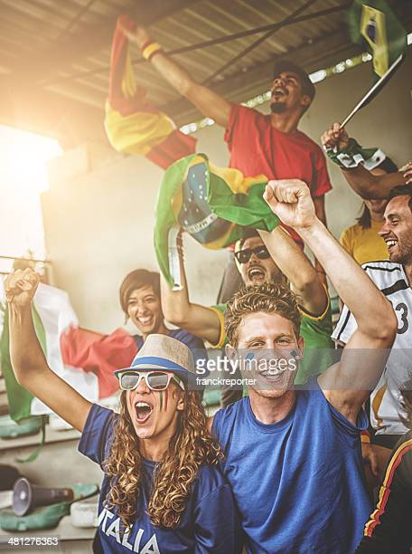 world supporter at the soccer stadium - fan enthusiast stock pictures, royalty-free photos & images