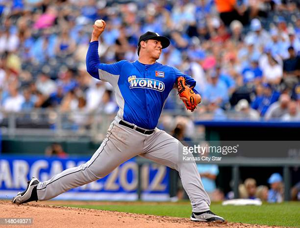 World Team pitcher Jose Fernandez delivers a pitch during the AllStar Futures baseball game at Kauffman Stadium in Kansas City Missouri Sunday July 8...