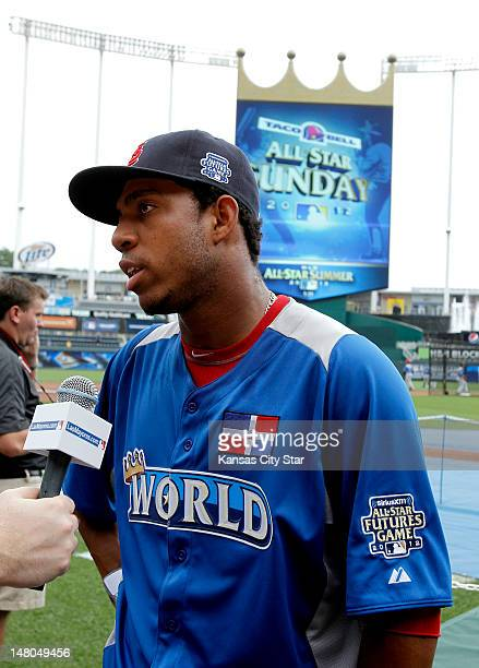 World Team right fielder Oscar Taveras talks with reporters during the AllStar Futures baseball game at Kauffman Stadium in Kansas City Missouri...