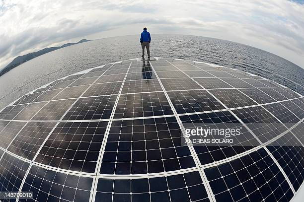 STORY ' World tour on a solarpowered boat to beat climate change' by Sonia Logre German Jens Langwasser bosun of Planetsolar catamaran the first boat...
