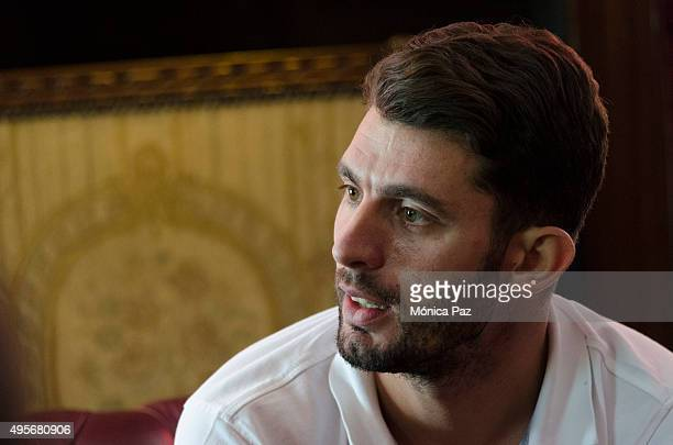 World Touring Car Championship driver champion Jose Maria Pechito López from Argentina speaks during an interview on November 04 2015 in Buenos Aires...