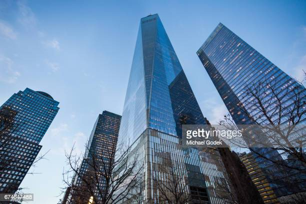 world trade center at dusk with vivid blue sky and reflections on glass - inquadratura dal basso foto e immagini stock