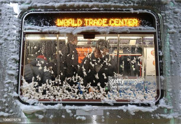 World Trade Center bound PATH train is covered in snow as it sits in Newark Penn Station on November 15 2018 in Newark New Jersey