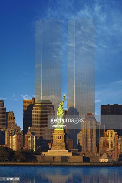 world trade center fading behind statue of liberty - twin towers manhattan stock photos and pictures
