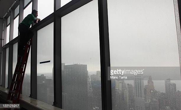 World Trade Center photographer Joe Woolhead takes a photo from the 53rd floor of 7 World Trade Center as construction continues on the National...