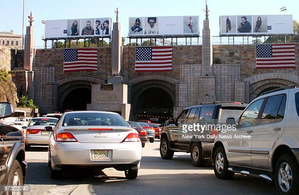 World Trade Center Terrorist AttackAmerican flags hang over the entrances at the New Jersey side of the Lincoln Tunnel as commuters return to...