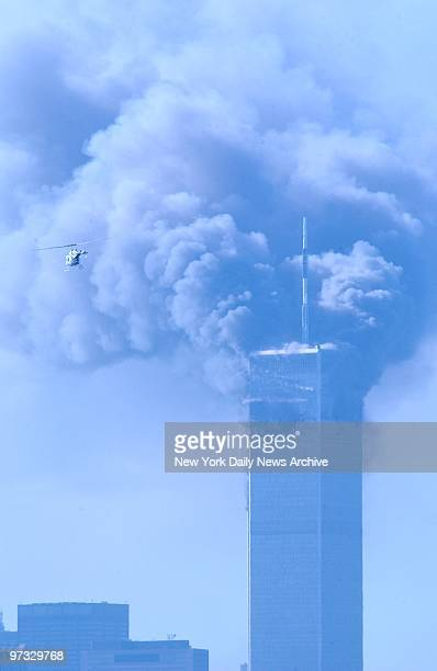World Trade Center Terrorist Attack-Smoke billows from 2 World Trade Center after it was struck by an airplane in a terrorist attack. A hijacked...