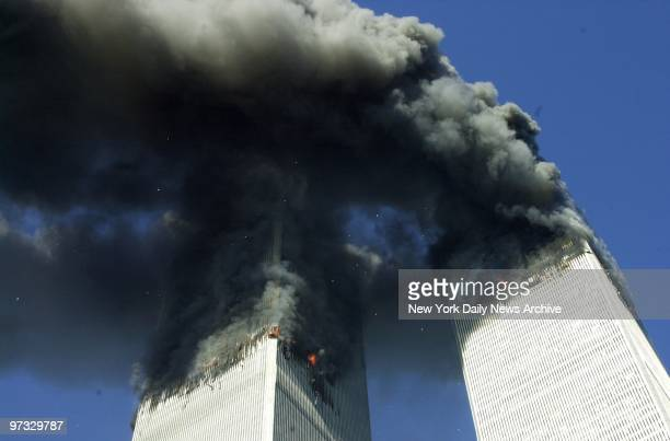 World Trade Center Terrorist Attack-Smoke billows from the twin towers of the World Trade Center - the aftermath of a terrorist attack. A hijacked...