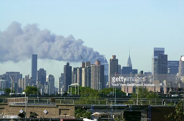 World Trade Center Terrorist Attack-Smoke billows over lower Manhattan after 1 World Trade Center collapses - the aftermath of a terrorist attack. A...