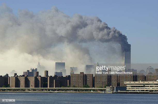 World Trade Center Terrorist Attack-Smoke billows over lower Manhattan after 1 World Trade Center collapse - the aftermath of a terrorist attack. A...