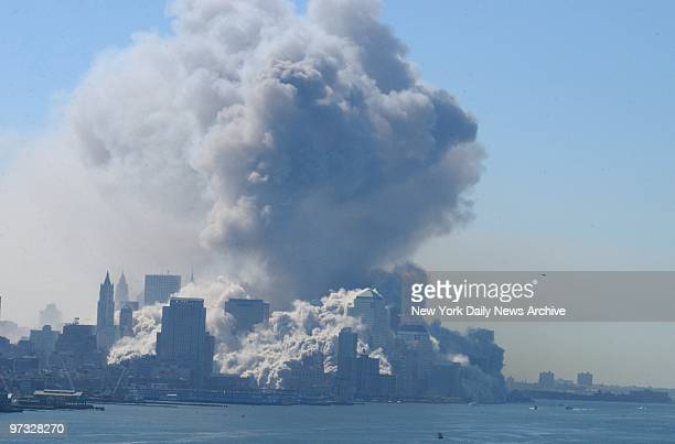 World Trade Center Terrorist Attack-World Trade Center Terrorist Attack-A vast billow of smoke rises into the air over Manhattan as the twin towers...