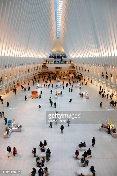 world trade center transportation hub or oculus in new york - hub stock pictures, royalty-free photos & images