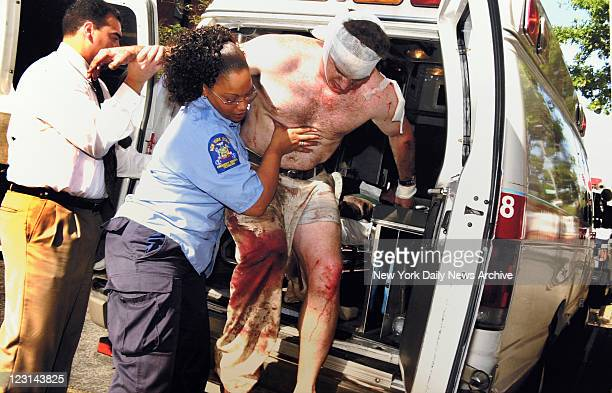 World Trade Center victim is helped off an ambulance to a hospital.