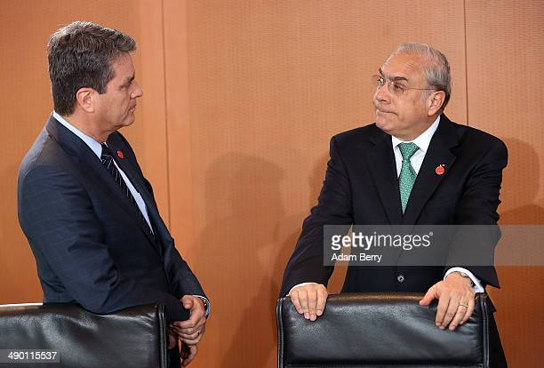 World Trade Organization Director General Roberto Azevedo and Organisation for Economic Cooperation and Development Secretary General Angel Gurria...