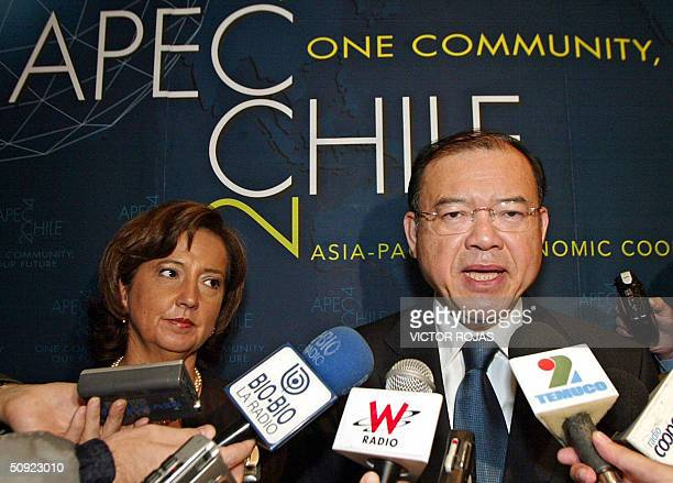 World Trade Organization General Director Supachai Panitchpakdi speaks to the press next to Chile's Minister of Foreign Affairs Soledad Alvear during...