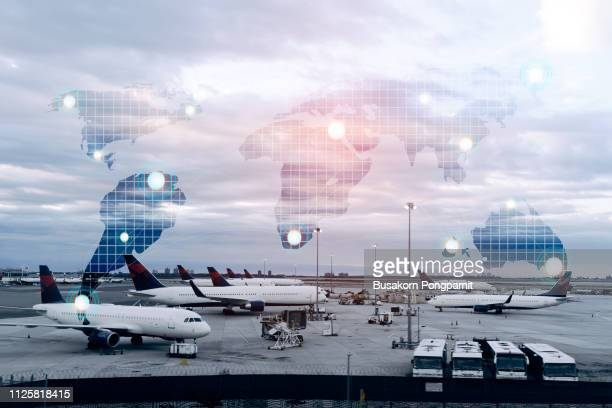 world travel map with airplanes, transportation and technology concept
