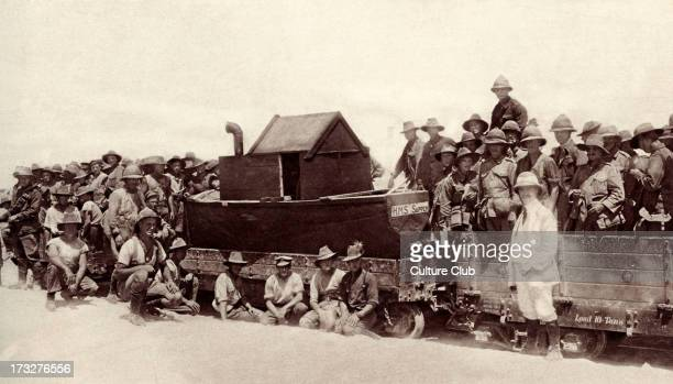 'Anzac Day' celebrations on the Suez Canal, Egypt, 25 April 1916. Soldiers pictured with HMS Sapper, small boat built for regatta. National day of...