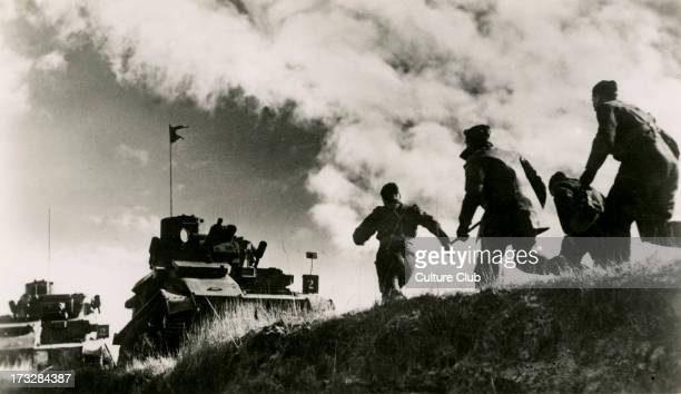 British cavalry tank exercises in France. War Office Photograph No.B.1947. Caption:' 'Action!' The crew run to their cavalry tank during exercises in...