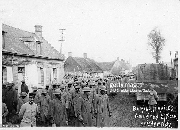 World War 1 burial services of American officer large group of African American soldiers in uniforms and hats organized outside for burial service...