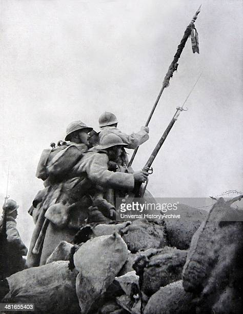 World War 1 - Heroic French soldiers rise over the top of their barricades towards the German line of fire during the First Battle of the Marne 1914....