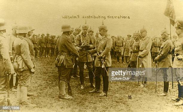 Kaiser Wilhelm II distributing decorations to German soldiers at the front British postcard