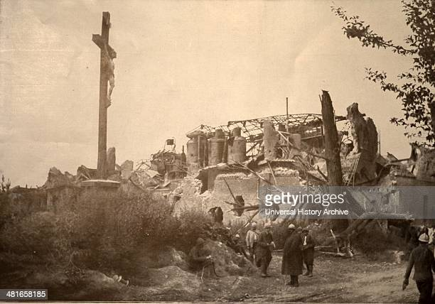 World War 1 one of the most tragic pictures of the battlefield of the Somme Candy Dompierre remained standing but shredded by shrapnel and a crucifix...