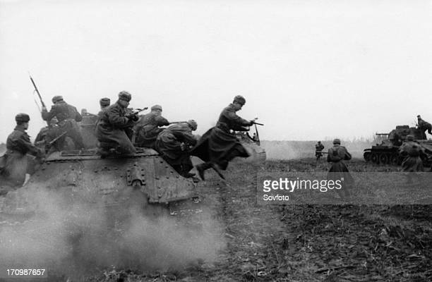 World war 2, 2nd ukrainian front, tank-borne soviet infantry attacking on the approaches to budapest, hungary, december 1944.