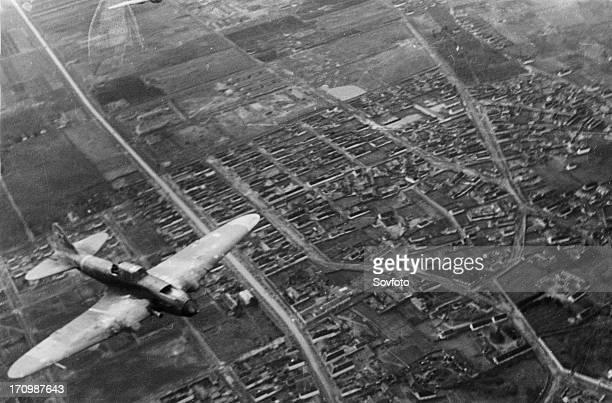 World war 2, 3rd ukrainian front, a soviet shturmovik plane flying over the city during the battle for budapest, january 1945.