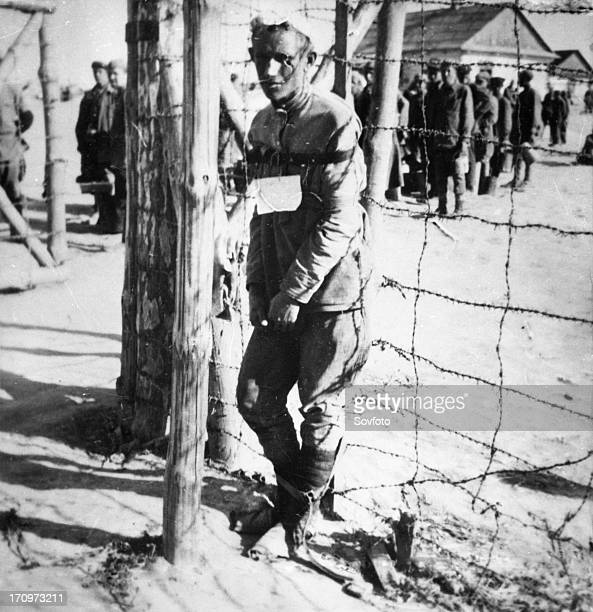 World war 2 a prisoner being forced to stand erect at a concentrtion camp for soviet prisoners of war in the lublin province of poland the photo was...
