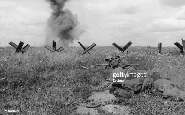 World war 2 august 1943 under cover of artillery fire four soviet sappers disarm a section of german defenses ukraine