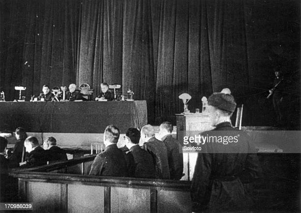 World war 2 december 15 still from a film on the kharkov trial produced by artkino judges prisoners docket and guard