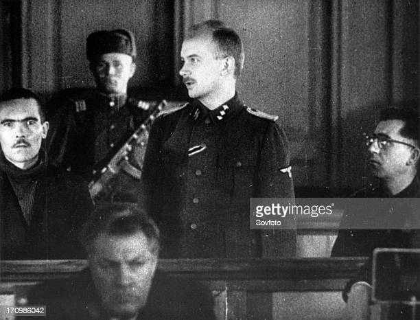 World war 2 december 15 still from a film on the kharkov trial produced by artkino hans ritz on the stand describing his crimes