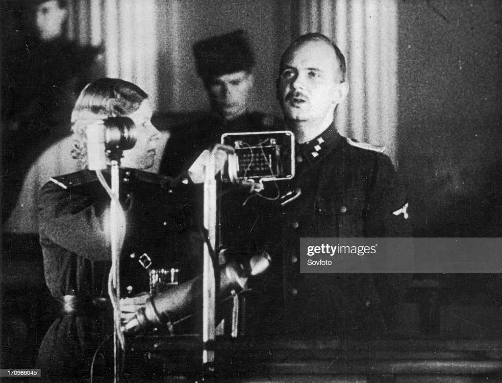 World war 2, december 15, 1943, still from a film on the kharkov trial produced by artkino, hans ritz pleads guilty, the woman is the court translator. : Nachrichtenfoto