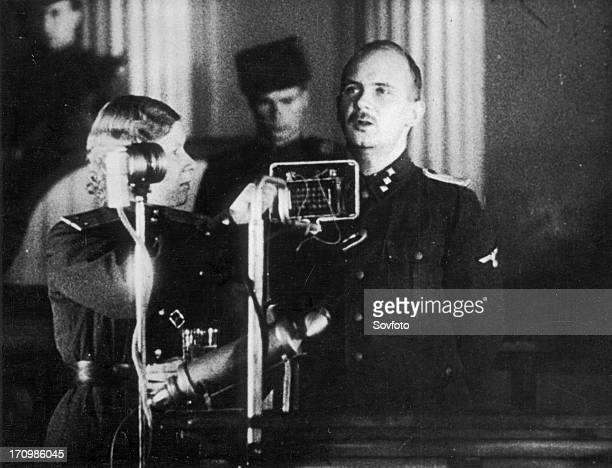World war 2 december 15 still from a film on the kharkov trial produced by artkino hans ritz pleads guilty the woman is the court translator