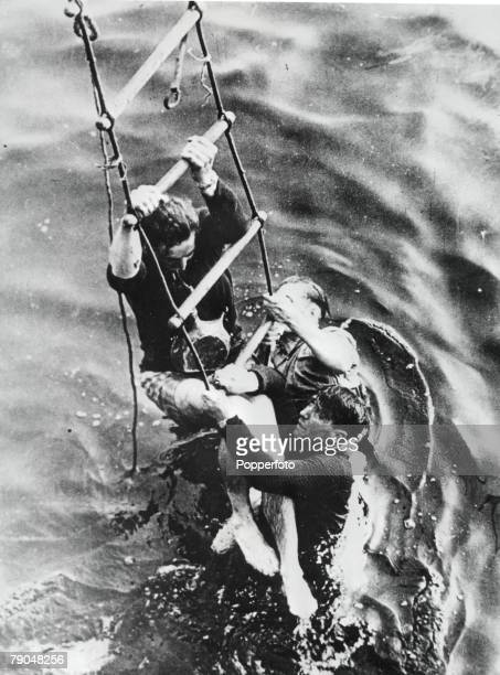 World War 2 Dunkirk France June 1940 Survivors climb a ladder to safety on their escape from the Nazis on the beaches of Dunkirk