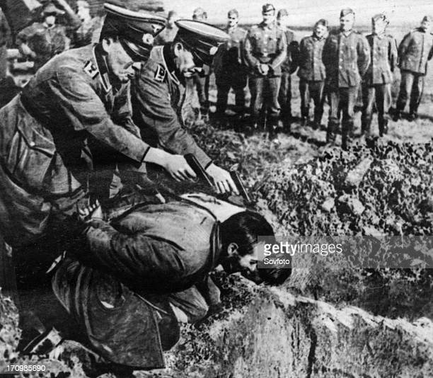 World war 2 german gestapo officers executing russian peasants september 1943 the photo was taken by a german soldier captured by the red army