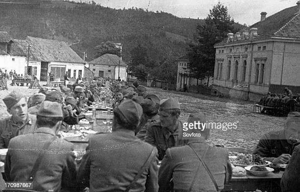 World war 2 soldiers of the national liberation army at a dinner arranged for them in the town of brus december 1944
