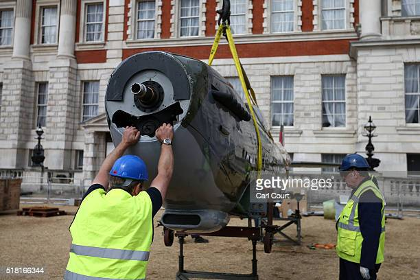 World War 2 Spitfire Mk XVI is moved into position from a truck at Horse Guards Parade on March 30 2016 in London England The RAF Museum will display...
