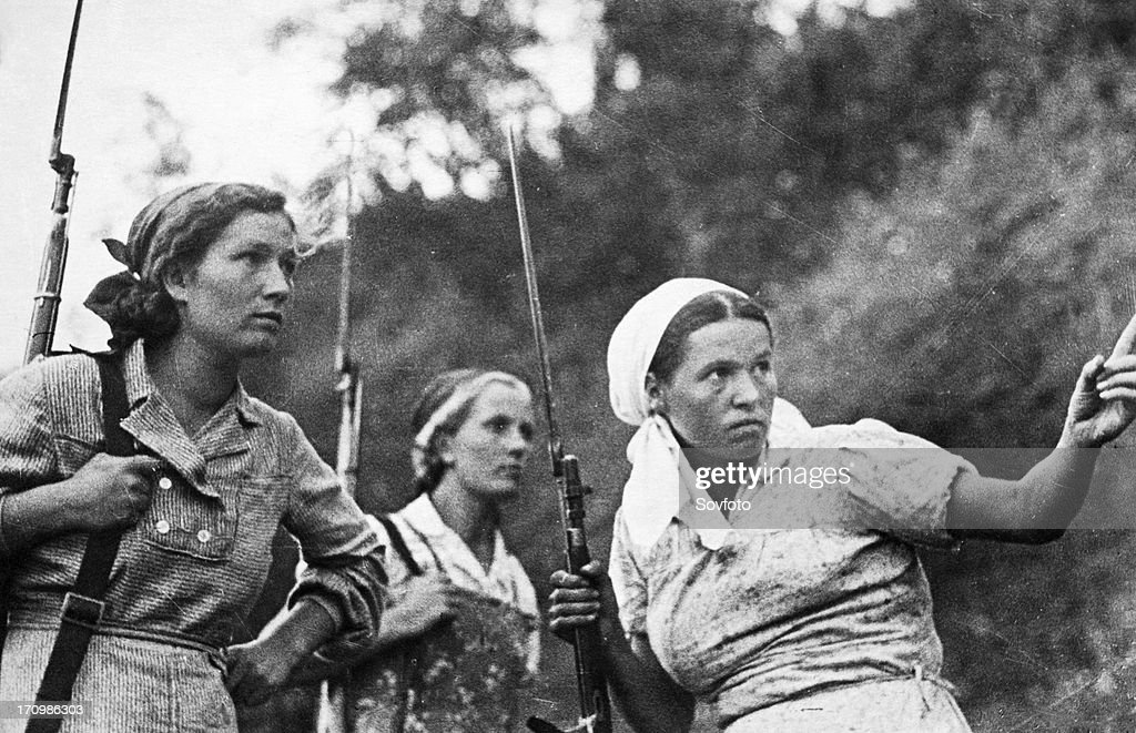World war 2, three young women, collective farmers from village 'n' who have joined the partisans, august 1941. : News Photo