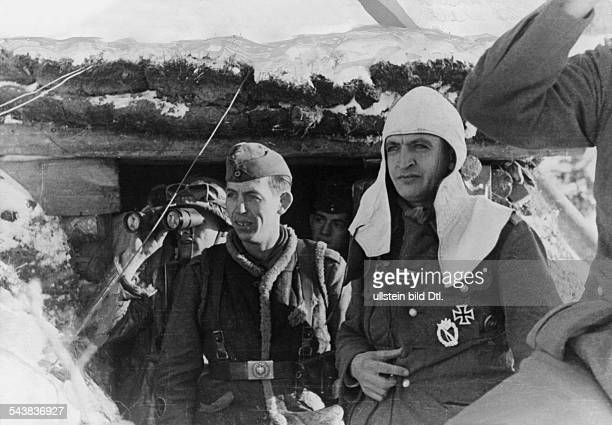 2 World War Eastern Front Soviet Union soldiers at the exit of a bunker watching battlesPhotograph war correspondaent Etzold Photographer...