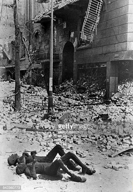 2 world war germany bomb warTwo corpses in a street of Hamburg after a british bomb attack
