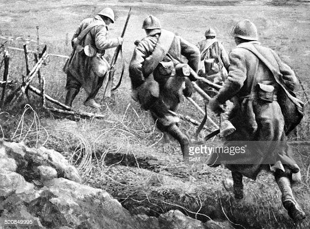 World War I 1914 1918 France Western Front French infantry assault comes from the trench overcoming a barrier of barbed wire