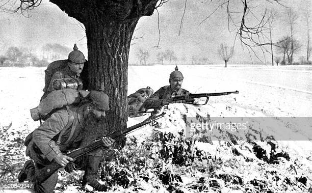 World War I 1914 1918 Invasion of Belgium German soldiers with the typical spiked helmet advance on a ground covered by snow during the first winter...