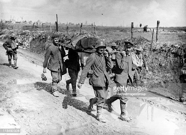 World War I 19141918 A Canadian casualty of the Battle of Vimy Ridge April 1917 being evacuated by stretcher bearers Wounded