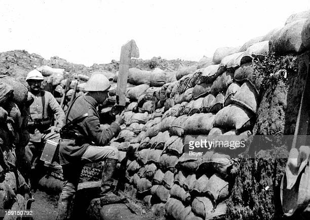 World War I A lookout using a periscope in a trench on the French front in 1916